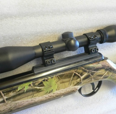 Real camo dipped rifle