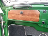 Shot of glove compartment customised with wood grain hydrographics process